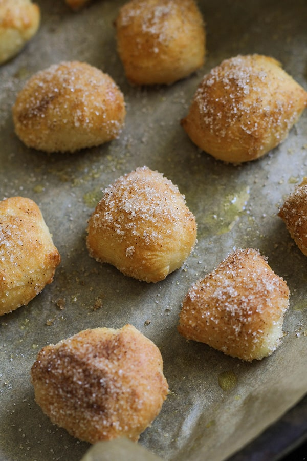 pretzel bites covered in cinnamon sugar on a baking tray.