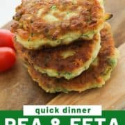 "fritters stacked on top of each other on a wooden board with text overlay ""pea & feta cheese fritters""."