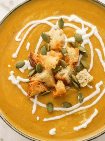 pumpkin soup topped with croutons, greek yoghurt and pumpkin seeds.