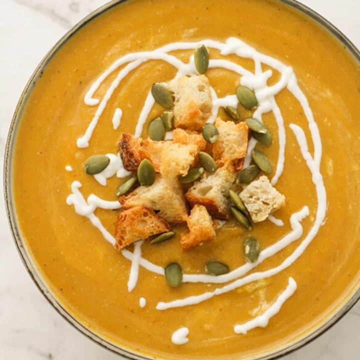 pumpkin soup topped with croutons, greek yoghurt and pumpkin seeds.