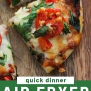 "a pizza slice on a wooden board with text overlay ""air fryer spinach & feta pizza""."