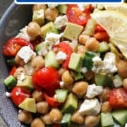 "salad in a blue bowl with text overlay ""chickpea, avocado & feta salad""."