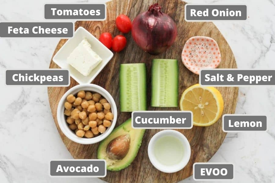 ingredients for salad on a wooden board.