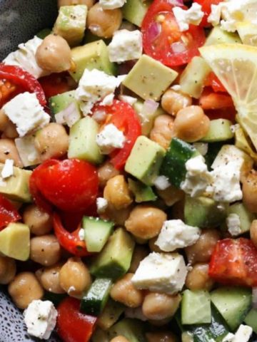 chickpea salad in a blue bowl.