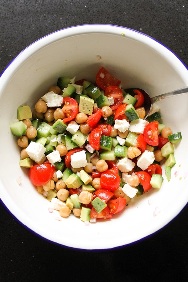chickpea salad in a white bowl.