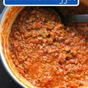 "a large pot of chilli with text overlay ""chilli con carne with hidden veggies""."