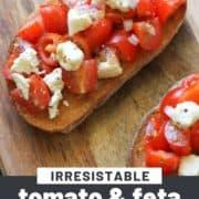 """bruschetta on a wooden board with text overlay """"tomato & feta bruschetta""""."""