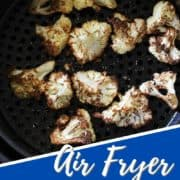 "roasted cauliflower in an air fryer basket with text overlay ""air fryer roasted cauliflower""."