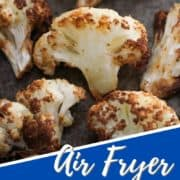 "roasted cauliflower on a baking tray with text overlay ""air fryer roasted cauliflower""."