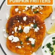 "two pumpkin fritters on a white plate topped with feta and parsley with text overlay ""pumpkin fritters""."