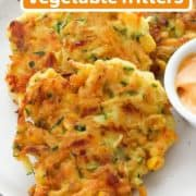 "fritters on a white plate with text overlay ""quick & crispy veggie fritters""."