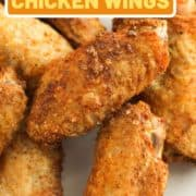 "chicken wings on a white plate with text overlay ""air fryer chicken wings""."