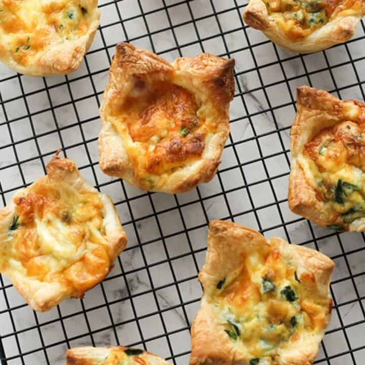 cooked mini quiches on a cooling rack.