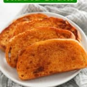 "slices of cheese toast on a white plate with text overlay ""sizzler copycat cheese bread""."