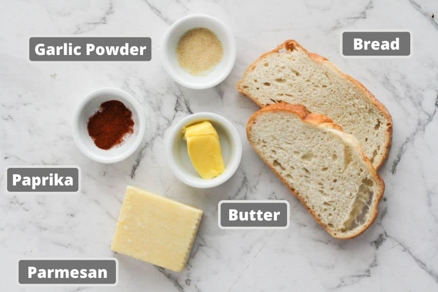 ingredients for sizzler cheese toast including sourdough bread, parmesan cheese and butter.