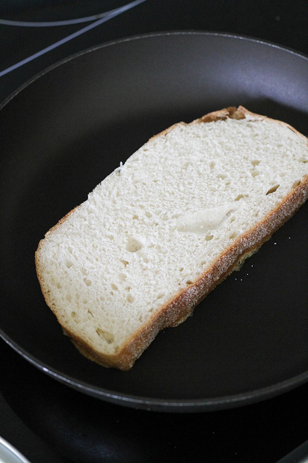 slice of bread in a skillet.