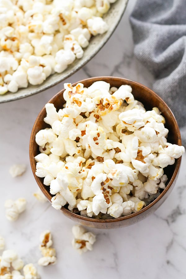 popcorn in a brown bowl.
