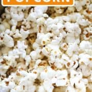 "popcorn in a saucepan with text overlay ""sweet & salty popcorn""."