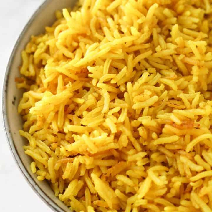 yellow rice in a grey bowl.