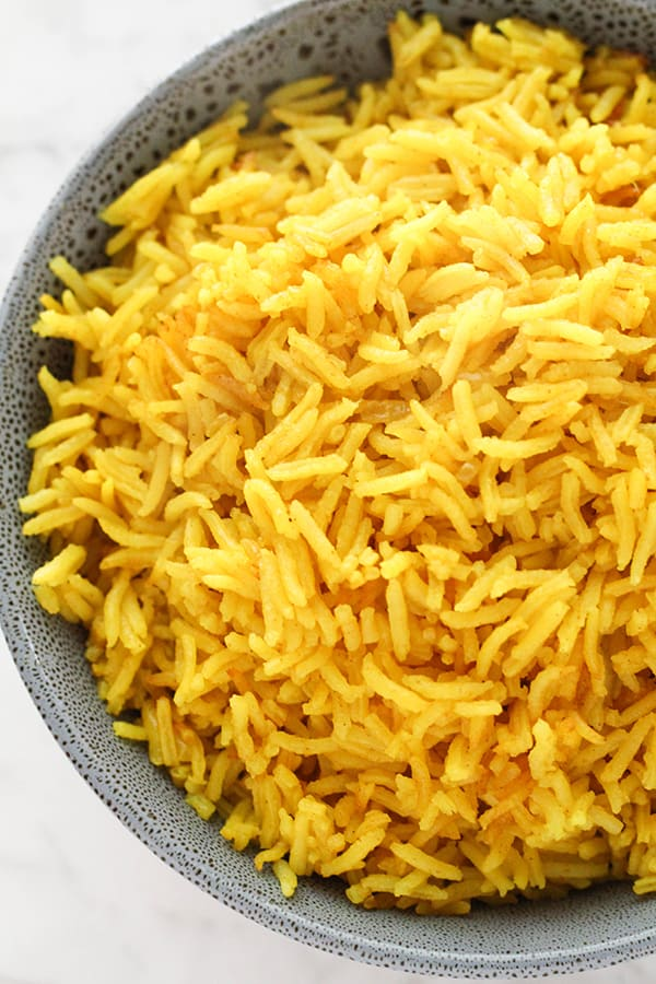 yellow rice in a blue bowl.