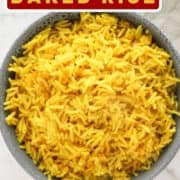"""yellow rice in a blue bowl with text overlay """"turmeric rice""""."""