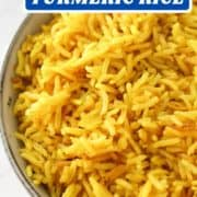 """yellow rice in a blue bowl with text overlay """"easy oven baked turmeric rice""""."""