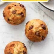 "banana muffins on a marble countertop with text overlay ""one banana muffins"".."