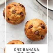 "banana muffins on a marble countertop with text overlay ""one banana one bowl muffins"".."