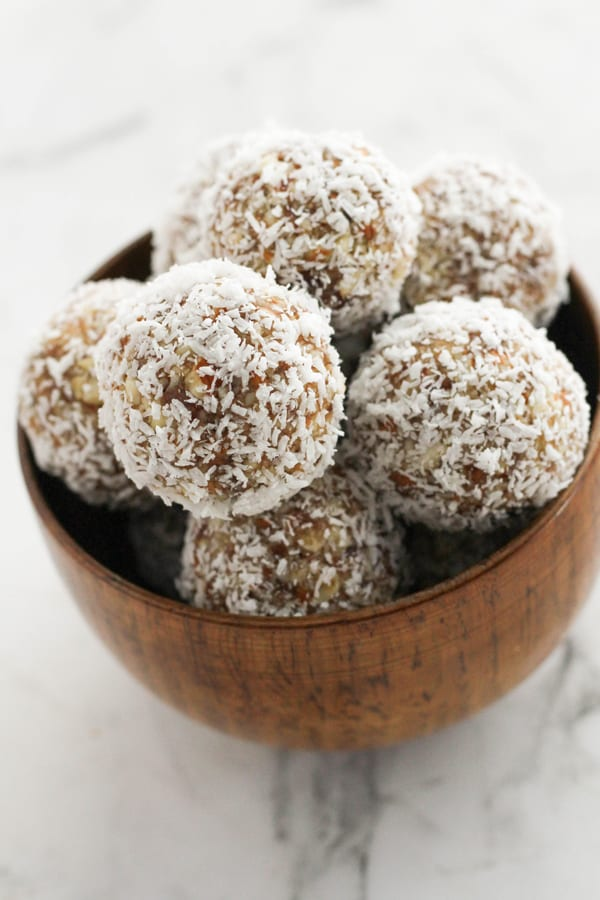 energy balls in a wooden bowl.