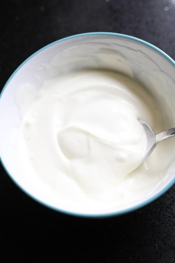 garlic sauce in a white bowl.