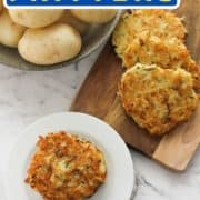 "stack of fritters on a plate with a bowl of potatoes in the background and text overlay ""potato & zucchini fritters""."