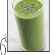 "green smoothie in a tall glass topped with chia seeds with text overlay ""spinach apple smoothie""."