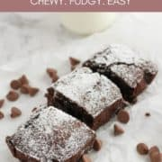 "chocolate brownie slices on top of white baking paper with text overlay ""air fryer brownies""."