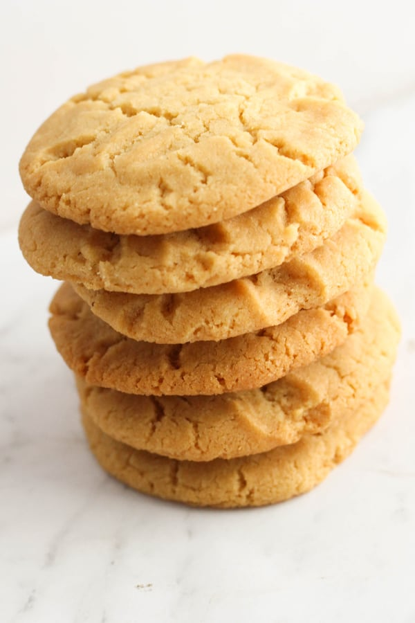golden syrup cookies stacked on top of each other.
