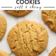 """cookies on a marble background with text overlay """"golden syrup cookies""""."""