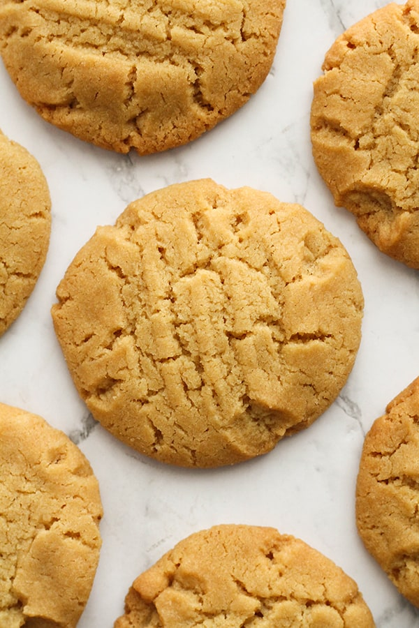 golden syrup cookies on a marble background.