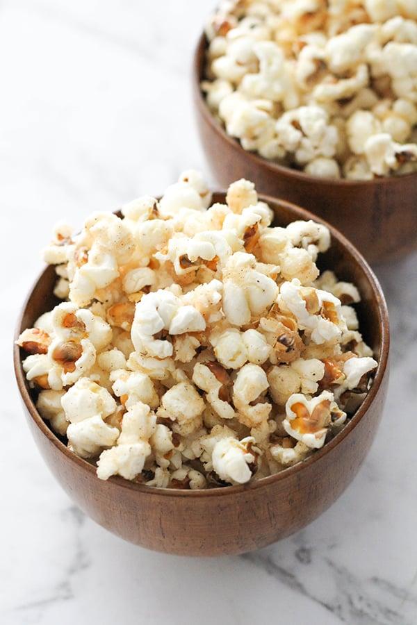 cinnamon sugar popcorn in wooden bowls.