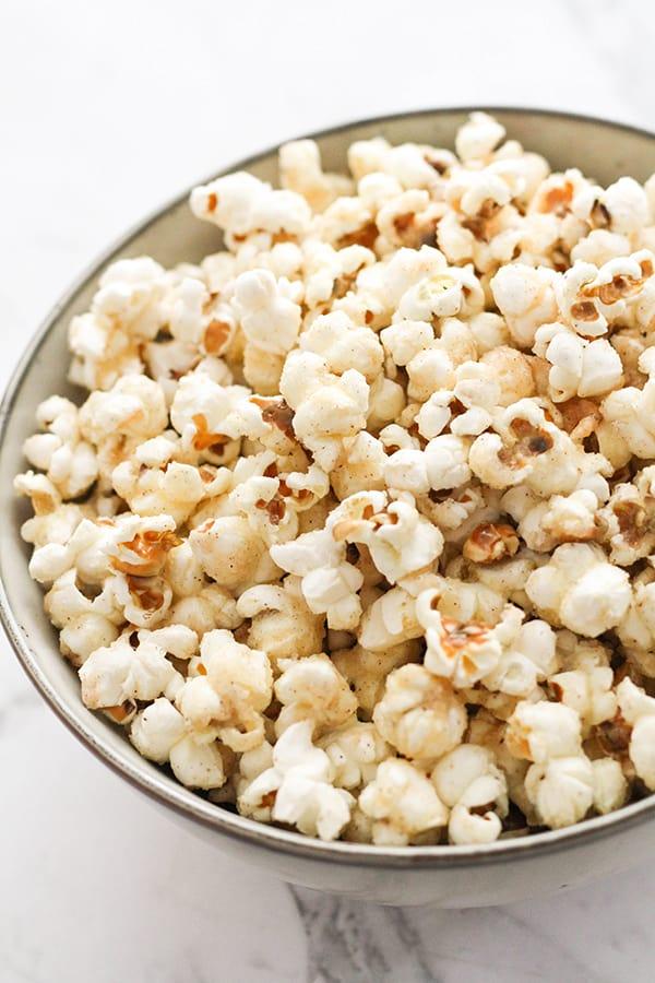 cinnamon sugar popcorn in a grey bowl.