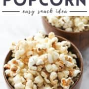 "popcorn in wooden bowls with text overlay ""cinnamon sugar popcorn""."