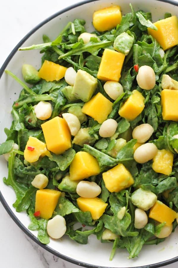 mango avocado salad in a white bowl.