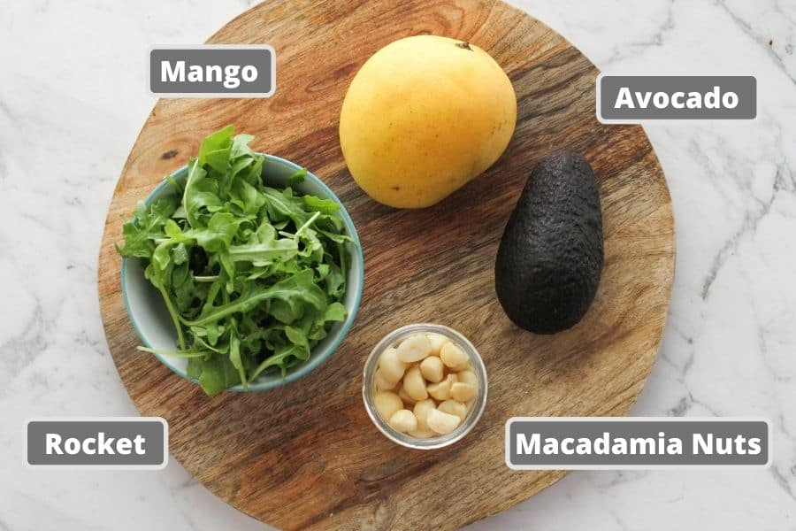 salad ingredients on a wooden board.