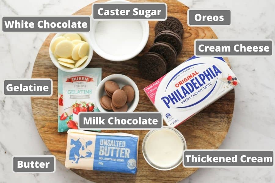 cheesecake ingredients including cream cheese, butter and chocolate.