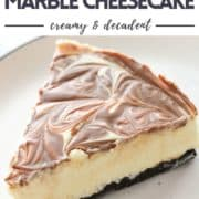 "a slice of cheesecake on the plate with text overlay ""no bake marble cheesecake""."