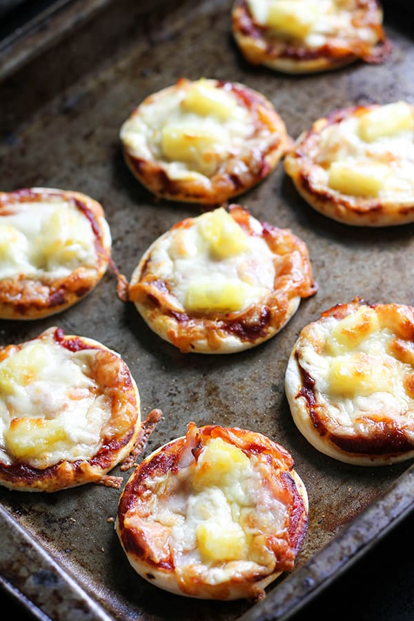 cooked mini pizza bites on a baking tray.