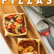 """pizzas on a wooden board with text overlay """"puff pastry pizzas""""."""