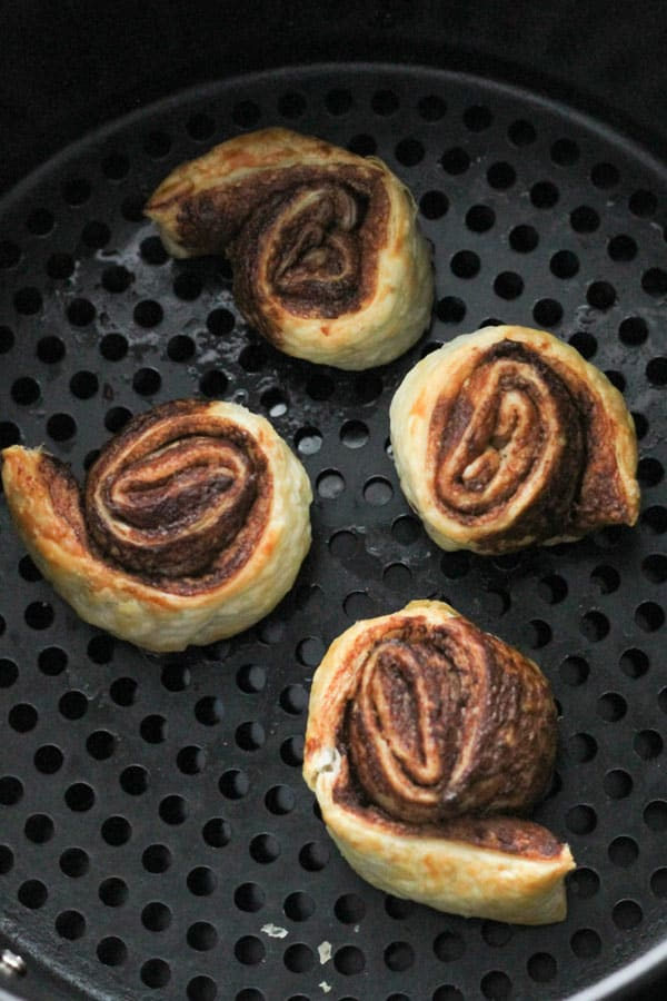 chocolate pinwheels in an air fryer basket.