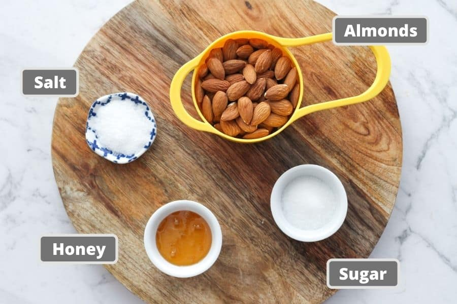 honey roasted almond ingredients on a wooden board.