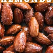 """almonds on baking paper with text overlay """"honey roasted almonds""""."""