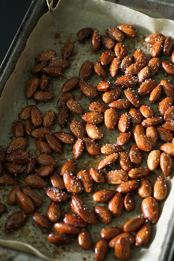 roasted almonds on a baking tray.