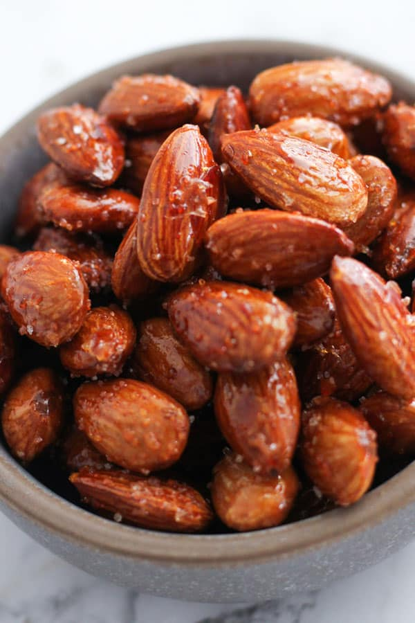 roasted almonds in a grey bowl.